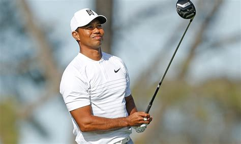 tiger woods commits  playing   honda classic