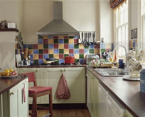 image multicoloured tiles above hob in modern kitchen