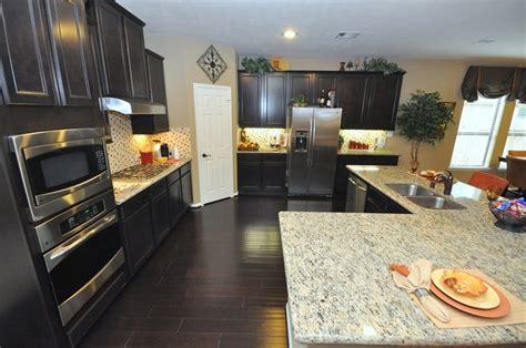 dark cabinets light granite dark kitchen cabinets and light granite countertop