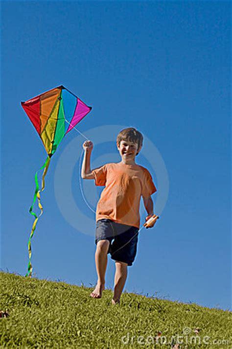boy flying  kite stock photo image