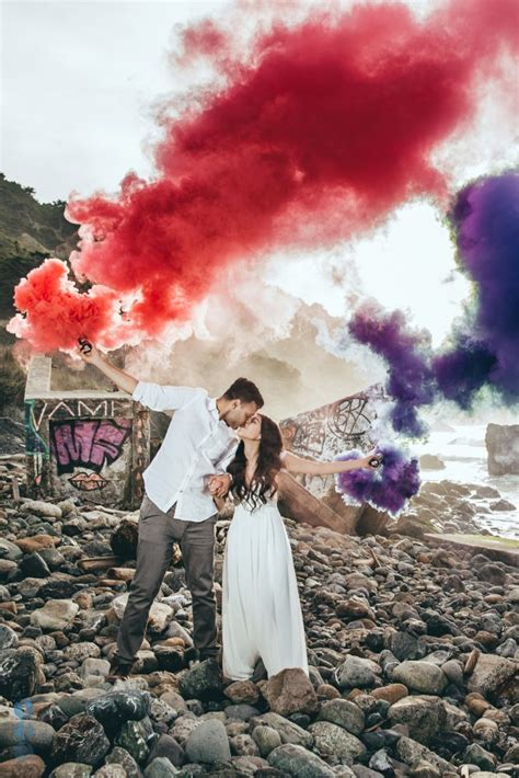 color smoke bomb engagement session with colored smoke bombs in san francisco