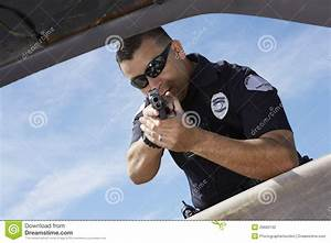 Police Officer Aiming Gun Through Car Window Stock Photo ...