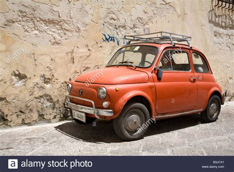 Old Red Fiat 500 Car With Roof Rack Parked In Lecce City