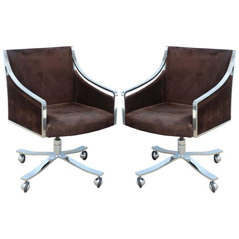 pair of mid century modern stow davis office desk chairs