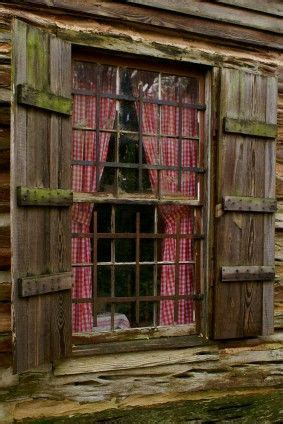 log cabin window   fashioned shutters  red