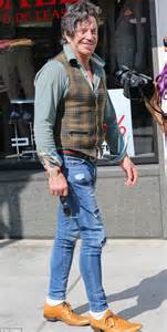 Mickey Rourke looks stylish in plaid vest as he strolls in ...