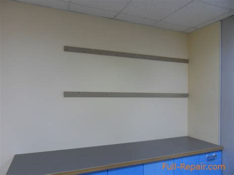 hanging cabinets on drywall kitchen cases on the walls of plasterboard