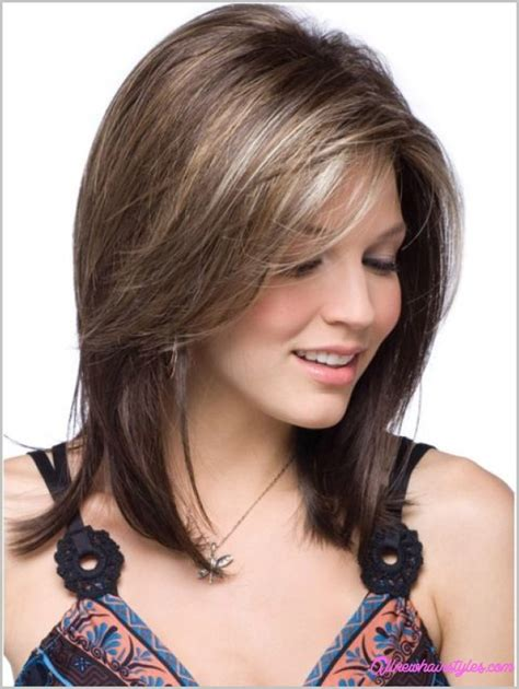 medium length haircuts with side swept bangs and layers