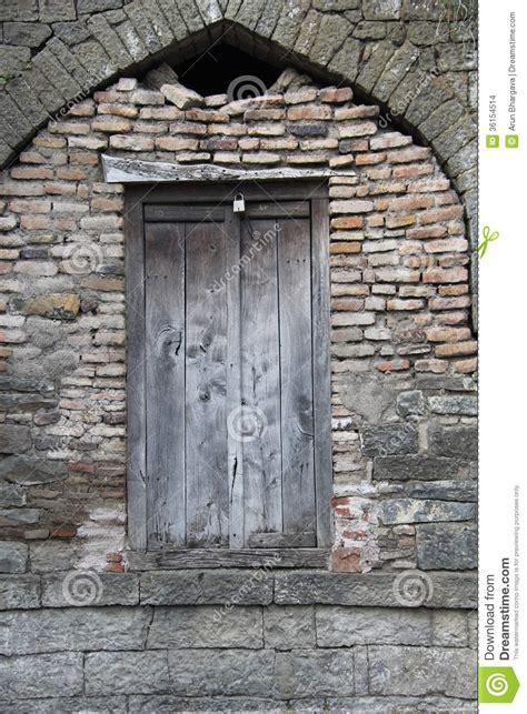 wooden door  brick stone wall stock images image