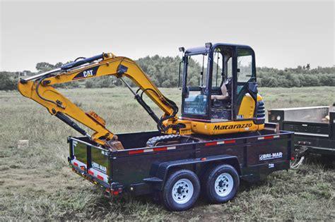 trailer  rented excavator compact equipment magazine