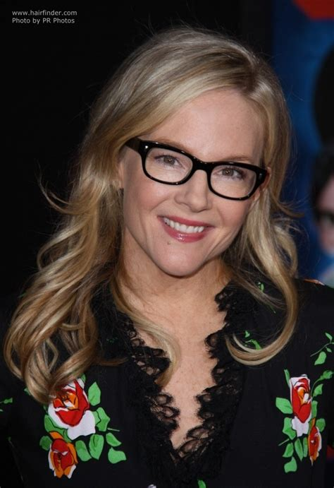 rachael harris black frame glasses  long hair