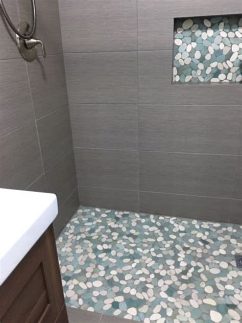 25 best ideas about pebble tile shower on pebble tiles pebble color and master