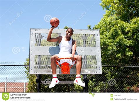 Sitting On The by Chion Basketball Player Sitting In Hoop Stock