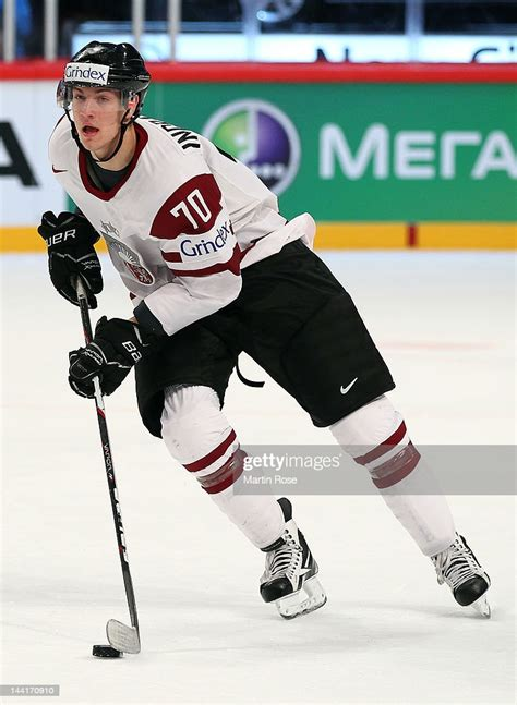 Miks Indrasis of Latvia controls the puck against Czech ...
