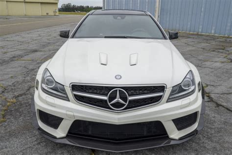 Shortly after driving the new c63 amg black series at its laguna seca press launch—nine hot laps only, and street driving witness the monster the doctor has birthed: 2012 MERCEDES C63 AMG Black Series - WDDGJ7HB1CF867392
