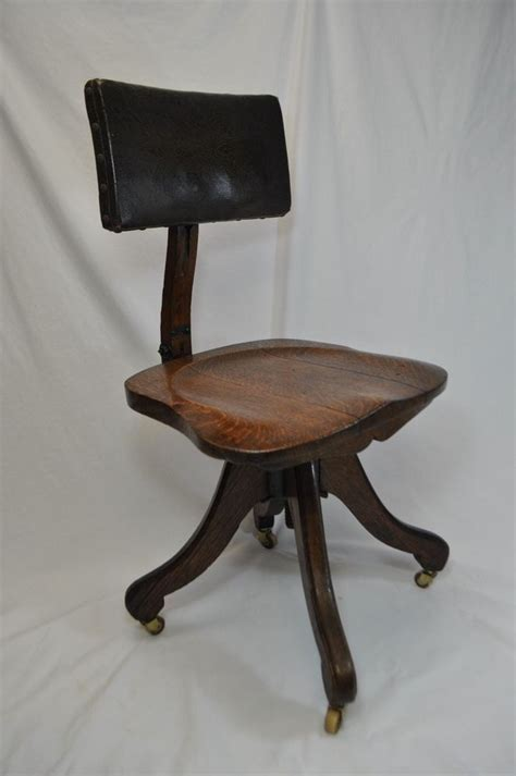 antique vintage wood and leather rolling office chair