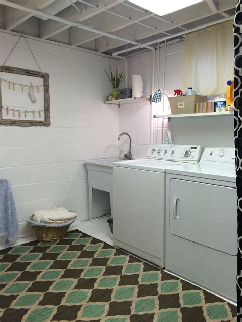 unfinished laundry room painted white added  rug