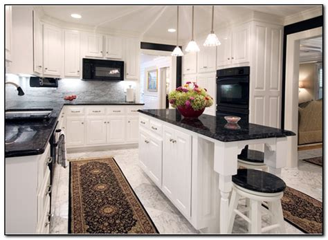 kitchen with black countertops for design home