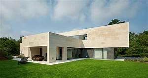 Limestone Home in Spain Creates Seamless Living Space