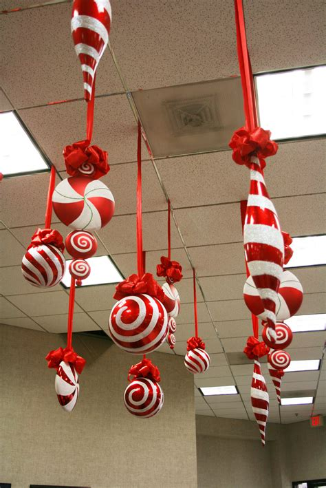 large candy christmas ornaments hanging from the ceiling