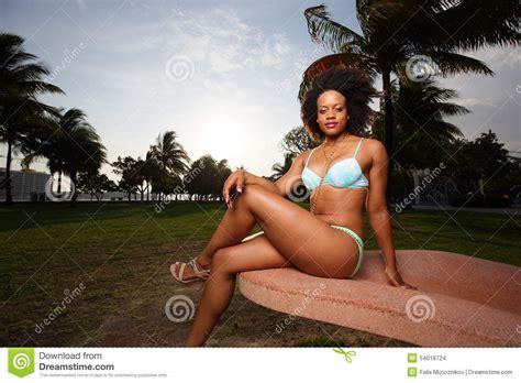 legs bikini woman in a bikini with legs crossed stock photo image