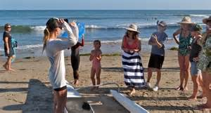 Safely back onshore, an outrigger canoist recounts her close encounter with a shark while she ...