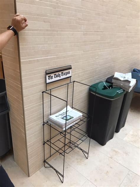 metal newspaper rack  levels  shelves