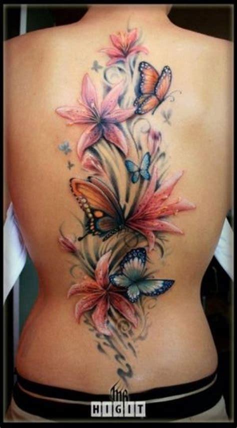 Tatouage Dos Complet Modele Tatouage Dos Complet Centre Fleurs De Lys Et Papillons Tatouage Femme