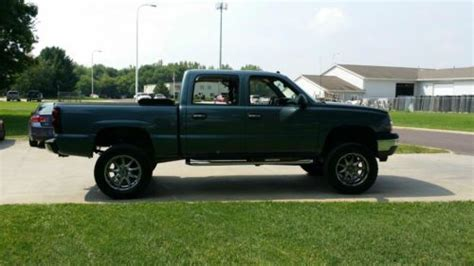 sell   chevy  crew cab lifted  peoria