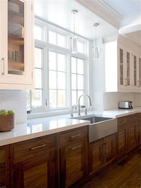 mixed wood kitchen cabinets wood cabinets mixed with white uppers in a kitchen via 7544