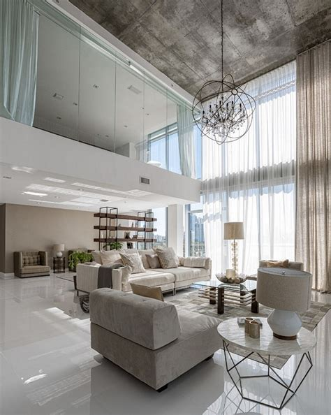 mesmerizing neutral living room design featuring tall windows and high ceiling design with