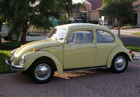black volkswagen bug looks like my very first car 1970 vw bug except primered