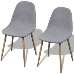 2 light grey fabric upholstery dining chairs iron legs