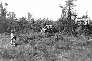 Combat engineers sweep an area with an SCR625 mine detector