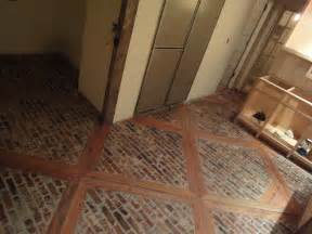 Tiling A Bathroom Floor On Plywood by Stone Floor With Wood Inlays Doityourself Com Community
