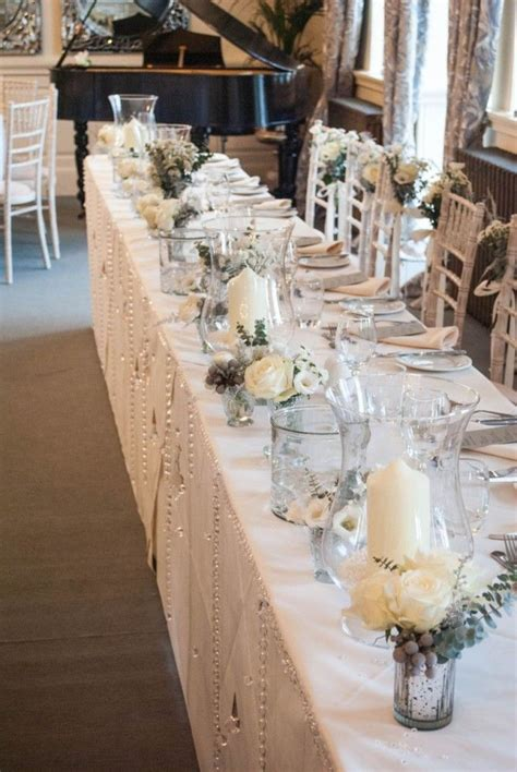 winter wedding ideas top table decoration small vases