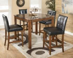 theo square counter height table set by ashley signature