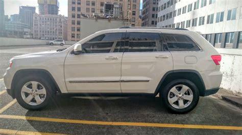 tan jeep grand cherokee 1j4rr4gg1bc600951 white jeep grand cherokee tan leather