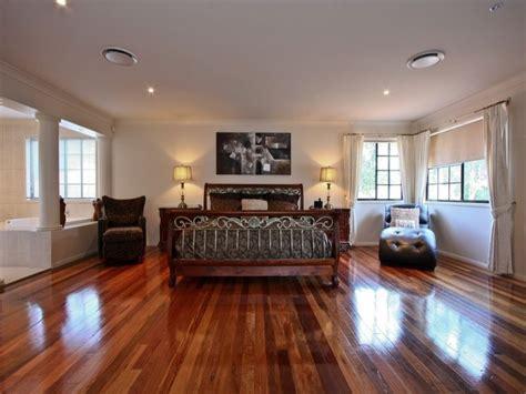 floorboard colours modern bedroom design idea with floorboards bi fold windows using beige colours bedroom