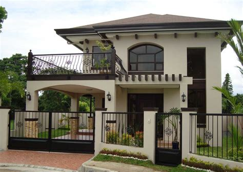 Two Story House With Balcony With Black Iron Railing