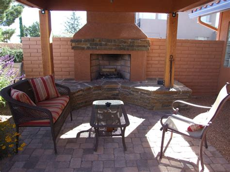 outdoor fireplace and covered patio