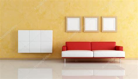 Divano Rosso E Bianco In Un Soggiorno Arancio