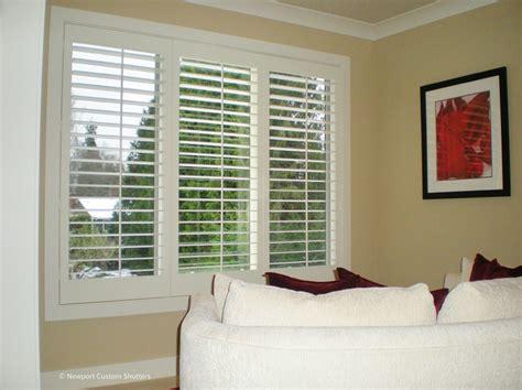 plantation shutters traditional bedroom seattle  newport custom shutters