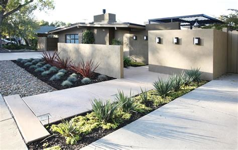 modern front yard the low wall brings separation from the street and a sense of arrival taller walls extend the