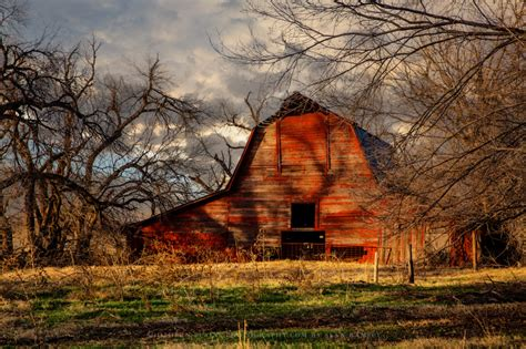 red barn photography wall art print picture    barn sitting  shadows  leafless