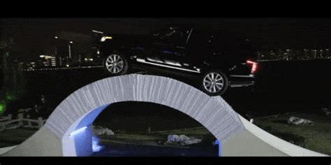 land rover drives   bridge   paper