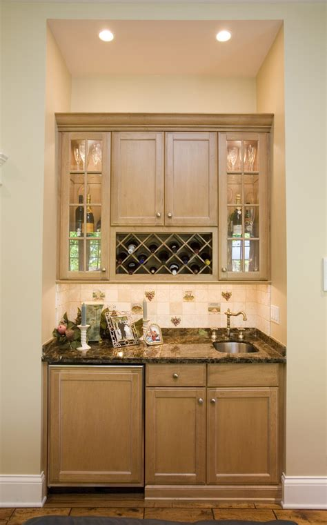 Bright Kitchen Lighting Ideas - wet bar cabinets with sink kitchen traditional with accent tiles alcove barware