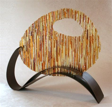 hand  amber circle fused glass  metal sculpture