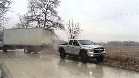 lifted dodge ram pulls  stuck semi truck youtube