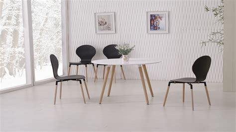 White Dining Table And Chairs by White Dining Table And 4 Black Chairs Homegenies